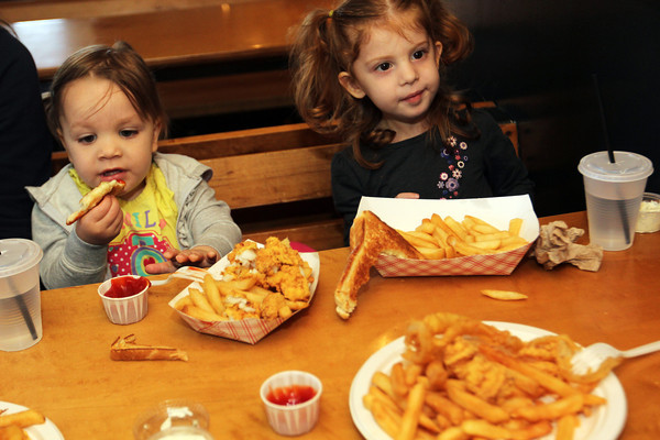 Emma Pietal, 3, right, and Chloe Pecci, 2, at lunch at Woodman's. Photo by Allegra Boverman.