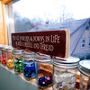 Jars of rainbow colored buttons are nearby when the creations of Amanda Thurston call for the adornments.<br /> Photo by Jim Vaiknoras.