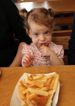 Molly Pietal, 1, enjoying her lunch at Woodman's. Photo by Allegra Boverman.