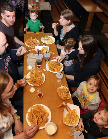 Enjoying lunch at Woodman's. Clockwise from lower left: Alex and Brian Pecci, Matt Pietal, Miles Pietal, 1, Rosie Pietal, Molly Pietal, 1, her cousin Maria Fournier of Hooksett, N.H., Chloe Pecci, 2, and Emma Pietal, 3. Photo by Allegra Boverman.
