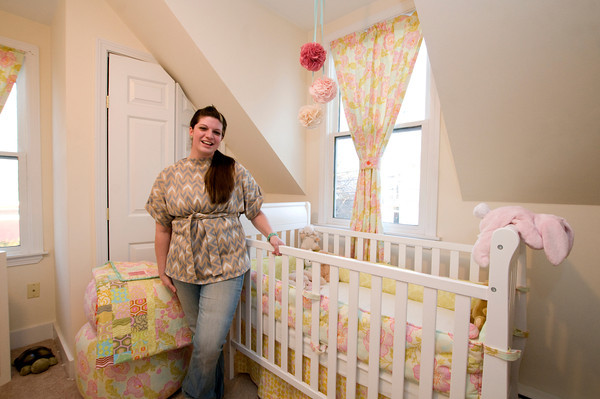 "Rockport's Amanda Thurston stands next to her custom-designed items, including her belted-tunic, baby crib bumpers, baby quilt, and curtains. The young seamstress founded Pink Armor by Amanda.  <a href=""http://www.pinkarmorbyamanda.com"">http://www.pinkarmorbyamanda.com</a>.<br /> <br /> <br /> Photo by Jim Vaiknoras."