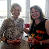 Joan Whitney and Dr Candice Thompson enjoy a drink at the retirment party for Gloucester Interim Police Chief Michael Lane  at the Cruiseport in Gloucester Wednesday night. JIm Vaiknoras/staff photo