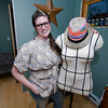 Amanda Thurston stands with her dress form (which she also made herself). She is sporting her belted tunic that she also made. Her custom-made tunics start at $40.<br /> Photo by Jim Vaiknoras.