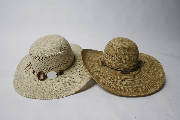 For summertime wear at the seashore or dining out on an outdoor patio,  Tropical Trends offers a fashionable wide-brimmed cover adorned with wooden leaves on knotted cord. $18.  Scala Collezione, handcrafted since 1921, offers a woven wide-brimmed hat in various natural colors. $18. Both styles available at Willoughby's at 20F Main St. in downtown Rockport.
