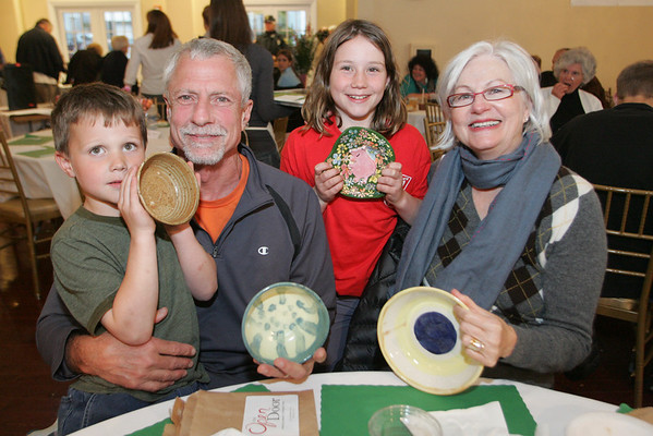 Gloucester: George and Suzanne Ulrich attend the Open Door/Cape Ann Food Pantry's nineth annual Empty Bowl Dinner with their grandchildren Quinten Ulrich, 6, and Corryn Ulrich, 9, at Cruiseport. Mary Muckenhoupt/Staff Photo