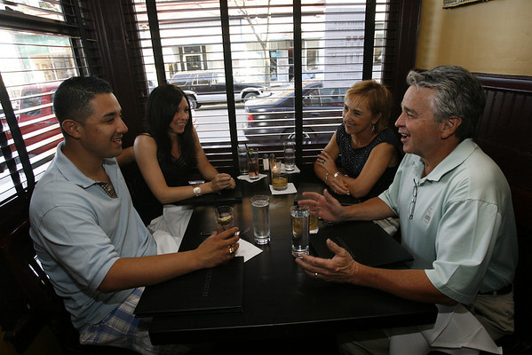 From left: Ismael Henriquez, Alli Berry, Andrea Berry, and Robert Berry, enjoy the window table at the Franklin Cafe. Staff photo/Kate Glass