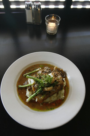 Gloucester: A signature dish at the Franklin Cafe is pan-seared North Atlantic cod served with oyster mushrooms, scallions and ginger and served over chive mashed potatoes, and finished in a citron blanc sauce. Staff photo/Kate Glass