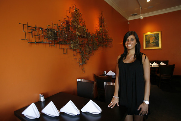 Franklin owner Maria Seniti in their upstairs dining area. Staff photo/Kate Glass
