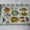 "This tropical fish wooden serving tray, 20"" x 13 3/4"" by Michel Design Works, can take any meal or libations outdoors to enjoy. $44. There are papers plates and other items to match. Available at Pisces at 96 Main St. in downtown Gloucester."