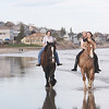Gloucester: Serena Barbara rides Frank with friends Mariah Place, 14, and her sister Chelsea on their horse Duke on Good Harbor Beach. The girls board their horses at Seaview Farm in Rockport. Staff photo by Mary Muckenhoupt