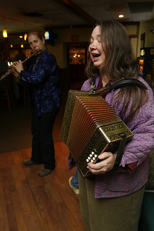 Rose Sheehan playing a melodeon,  a button accordion as she sings Sea Chanteys at Cameron's Restaurant. Staff photo/Kate Glass