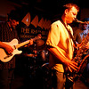 Dave Sag's Blues Party performs at the Rhumb Line every Thursday night. The band is comprised of Dave Saginario, bass, Greg Tower, guitar, and a rotating cast of guest musicians. Photo by Kate Glass<br /> <br /> Greg Tower on guitar, left, Leo Sharamitaro on drums, center, Mario Perrett on tenor, and Dave Saginario on bass.