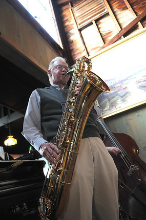Gloucester: Ralph Norris plays the baritone sax for the Barbara and Al Boudreau quartet. The group plays at the Studio Restaurant on Rocky Neck. during the summer. Photo  by Desi Smith.