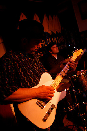 Dave Sag's Blues Party performs at the Rhumb Line every Thursday night. The band is comprised of Dave Saginario, bass, Greg Tower, guitar, and a rotating cast of guest musicians. Photo by Kate Glass<br /> <br /> Greg Tower on guitar and Leo Sharamitaro on drums.