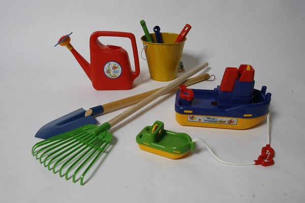 These assorted beach toys can lead to the creation of an enchanted sand castle or just fun in the sand. The Blue Lagoon ferry set by Wader, coupled together with a smaller boat, can be used in the backyard, bath or at the beach. $24. 95. Blue Lagoon watering container, $7.95; wooden-handled shovel, $6.95; wooden-handled rake, $6.95; assorted hand shovels and spade, $2.50; pail $5.95. Available at Silly Goose at 166 Main St. in Essex.