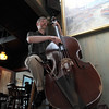 Bass player Mark Carlson of the Barbara and Al Boudreau Jazz Quartet plays Sunday May 24,2009 at the Studio on Rocky Neck. Desi Smith Photo