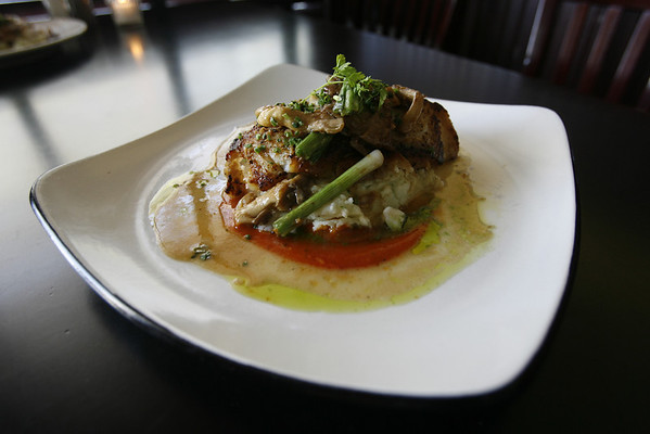 A signature dish at the Franklin Cafe is pan-seared North Atlantic cod served with oyster mushrooms, scallions and ginger and served over chive mashed potatoes, and finished in a citron blanc sauce. Staff photo/Kate Glass