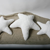 Helen Parker creates three sizes of star fish pillows made from recycled chenille bedspreads.  The costs are $   $  and $.  Available at Helen  Parker Textiles at 67 Broadway in Rockport.