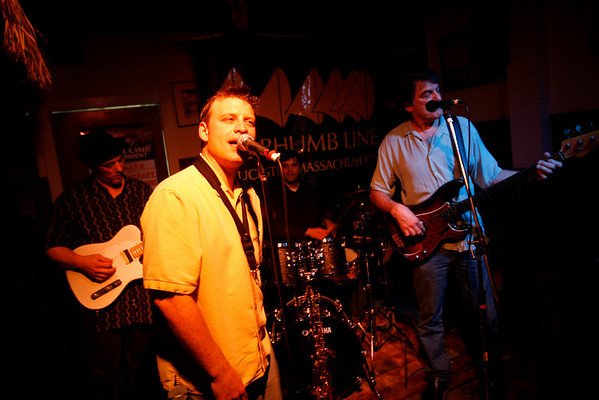 Dave Sag's Blues Party performs at the Rhumb Line every Thursday night. The band is comprised of Dave Saginario, bass, Greg Tower, guitar, and a rotating cast of guest musicians. Photo by Kate Glass<br /> <br /> Greg Tower on guitar, left, Mario Perrett on tenor sax and vocals, Leo Sharamitaro on drums, and Dave Saginario on bass and vocals.