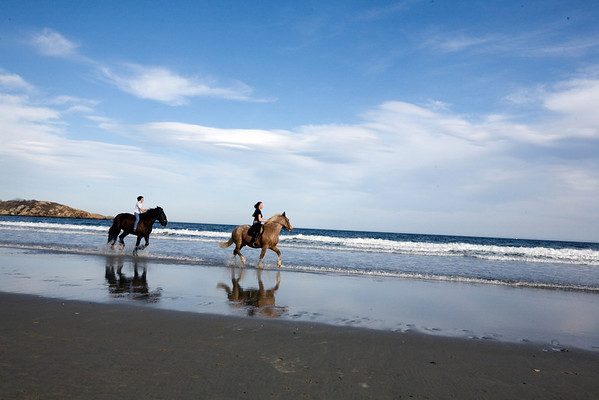 Gloucester: Serena Barbara canters on Frank with Mariah Place, 14,  riding her horse Duke on Good Harbor Beach on a warm April evening. Staff photo/Amy Sweeney