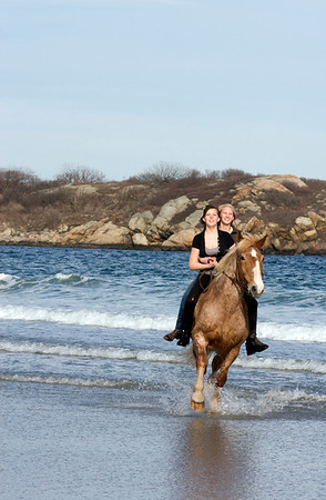 Gloucester: Mariah Place, 14, takes her sister Chelsea for a ride on their horse Duke on Good Harbor Beach on a warm April evening. Staff photo/Amy Sweeney