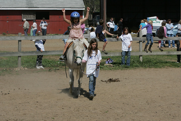 Rockport: Maddie Ryan, 12, of Rockport pulls her horse Crackerjacks as her sister Ericka, 8, goes for a ride at Seaview Farm.  Mary Mucknhoupt/Staff Photo