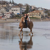 Gloucester: Mariah Place, 14, takes her sister Chelsea for a ride on their horse Duke on Good Harbor Beach on a warm April evening. Staff photo by Mary Muckenhoupt