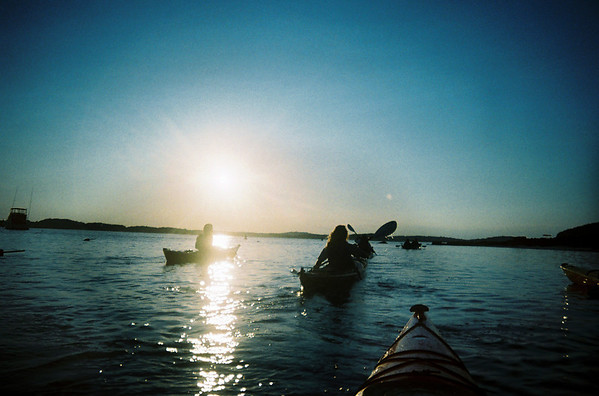 Essex: Kayakers paddle down the Essex River Basin toward Crane Beach during ERBA's Moonlight Tour. Because salt water is extremely damaging to cameras I did not want to bring my own cameras. This was shot this with a Kodak water-proof disposable camera. Staff photo/Amy Sweeney