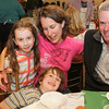 Gloucester: Jane and Ted Cunningham pictured with two of their three children, Cole, 5, and Aidan, 7, attend the Open Door/Cape Ann Food Pantry's nineth annual Empty Bowl Dinner held at Cruiseport. Mary Muckenhoupt/Staff Photo