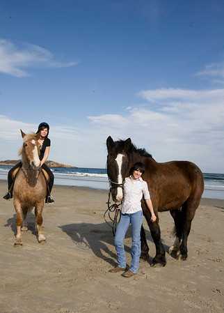 Gloucester: Mariah Place, 14, on Duke rides with Serena Barbara, 18, with Frank on Good Harbor Beach on a warm April evening. They board their horses at Seaview Farm in Rockport and often ride the beaches during the winter season. Staff photo/Amy Sweeney.