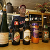 Eric Lorden, owner of Passports, shows several of his favorite beers from their offerings. The restaurant offers over 40 beers.