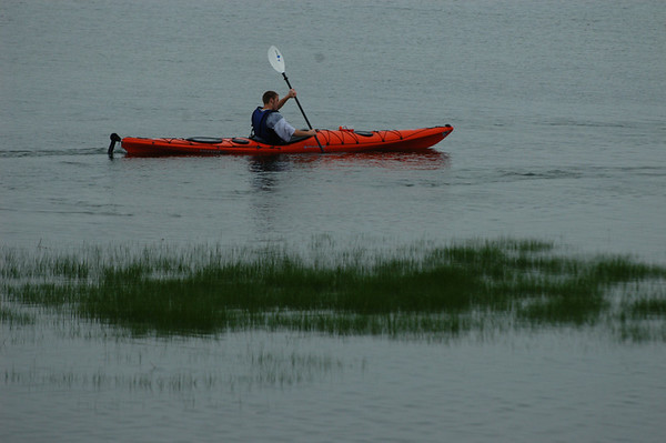 Essex: Dave Moller, 17, maneuvers his kayak off Conomo Point while on a guided trip with Essex River Basin Adventures in Essex. Moller was out with a group from the Merrimack Special Education Collaborative in Topsfield. Staff photo/Mike Dean