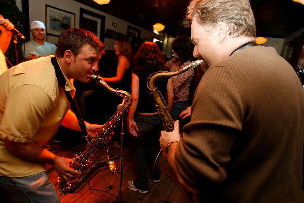 Dave Sag's Blues Party performs at the Rhumb Line every Thursday night. The band is comprised of Dave Saginario, bass, Greg Tower, guitar, and a rotating cast of guest musicians. Photo by Kate Glass<br /> <br /> Dueling tenors Mario Perrett, left, and Mark Earley