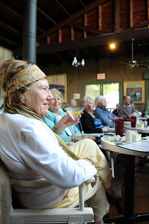Joan Ross Cummiskey enjoys a drink and some jazz music by Barbara and Al Boudreau Jazz Quartet with friends right,Dodie Gibbons Pomeroy,and Ann and Jim Leonard Sunday May 24,2009 at the Studio on Rocky Neck. Desi Smith Photo/Gloucester Daily Times.