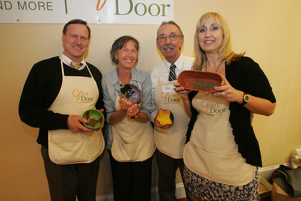 Gloucester: from left, David Slade, Juni VanDyke, Bob Ryan, and Heidi  Dallin all volunteered to help take tickets at the at the Open Door/Cape Ann Food Pantry's nineth annual Empty Bowl Dinner held at Cruiseport. Mary Muckenhoupt/Staff Photo