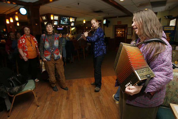 Peter and Joanne Souza lead the Sea Shanteys at Cameron's Restaurant every Tuesday night.