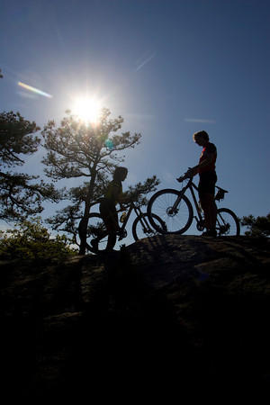 Coley Bryan and his wife Heidi Wakeman of Gloucester clime their mountain bikes to the top of Red Rocks in Gloucester to check out the breathtaking view. Photo by Mary Muckenhoupt
