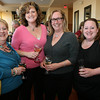 Gloucester: Sue Lufkin, Laurie Lufkin, Susan Coviello, and Kim Williams, all of Essex, enjoy some wine at the Taste of Cape Ann at Cruiseport. Photo by Kate Glass/Cape Ann Magazine