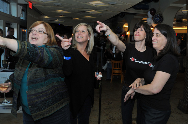 Gloucester:Amy Cole,Kristine Saputo,Michelle Philpott and Linda Rogers answer trivia questions for prizes asked by DJ Leo Frances Classic Hits at the fund- raiser for the GHS Athletics, at Lattatude 45 on Thursday night.Desi Smith Photo/Gloucester Daily Times. April 29,2010.