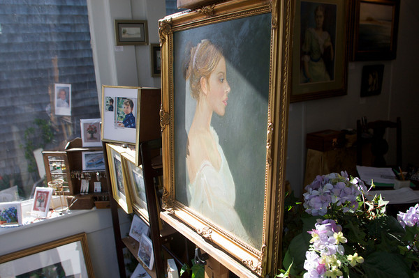 """A portrait titled """"Jucinta"""" painted by Luisa F.V. Cleaves that is displayed in the front window of Cleaves' Rockport Gallery. Photo by Mary Muckenhoupt"""
