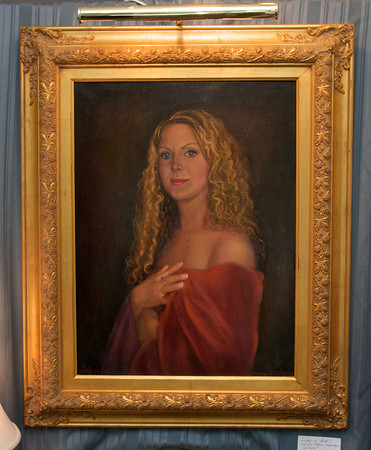 """A portrait titled """"Lady in Red"""" painted by Luisa F.V. Cleaves in Cleaves' Rockport Gallery. Photo by Mary Muckenhoupt"""