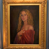 "A portrait titled ""Lady in Red"" painted by Luisa F.V. Cleaves in Cleaves' Rockport Gallery. Photo by Mary Muckenhoupt"