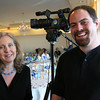 Lisa Smith and Andrew Love of Cape Ann TV attend Sinikka Nogelo's retirement party at Cruiseport.