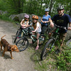 Sally and Bill Woodson of Rockport are avid mountain bikers and now their kids, Naomi, 9, (orange helmet) Becca, 7, and Sarah, 5, (in tow) are getting into it as well. Photo by Kate Glass