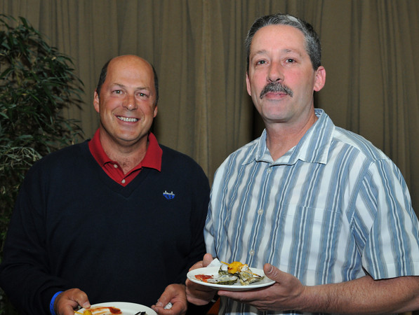 Gloucester: Jim Destino and Billy Sweet enjoy some appitizers while attending a fund raiser for the GHS Athletics, at Lattatude 45 on Thursday night.Desi Smith Photo/Gloucester Daily Times. April 29,2010.