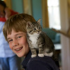 Gideon Roell, 11, with the family's new kitten Kiki. Photo by Mary Muckenhoupt