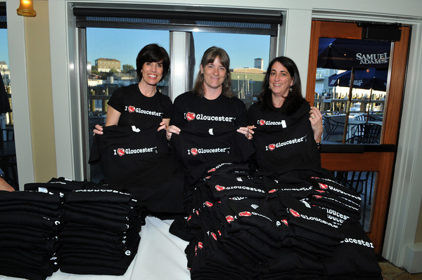 Gloucester: Michelle Philpott,Ellen Lufkin and Linda Rogers sell I love Gloucester Tee Shirts at a fund raiser for the GHS Athletics, at Lattatude 45 on Thursday night.Desi Smith Photo/Gloucester Daily Times. April 29,2010.