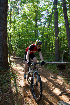 Coley Bryan of Gloucester bikes down a trail at Red Rocks in Gloucester. An experienced biker Bryan mountain bikes all over Cape Ann. Photo by Mary Muckenhoupt