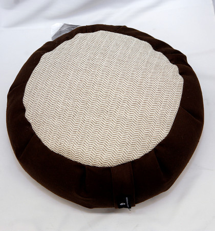 This may not do the actual yoga postisions for you, but this cushion is portable enough to travel to the beach, Zafu Yoga Cushion, GreenLife, $42 to $65