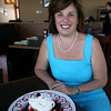 Sheree DeLorenzo, owner of Seaport Grille, with the dessert, the Sheree Berry, which was named after her. Photo by Kate Glass